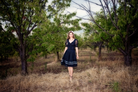 autmn: elegant woman stand in front of orchard, full body shot, autmn day