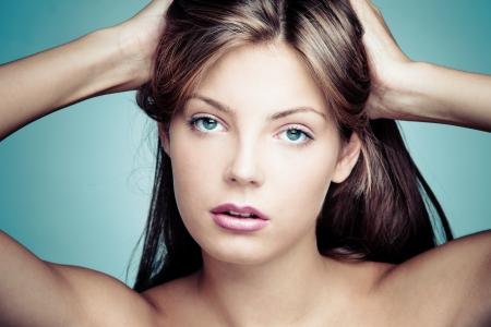 blue face: blue eyes beautiful young woman beauty portrait studio shot
