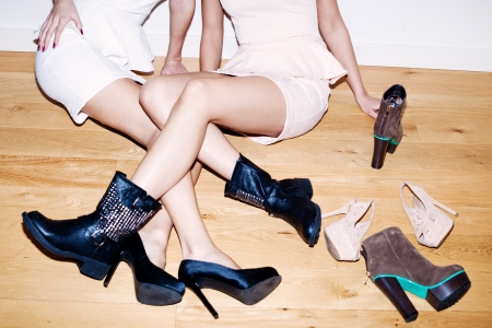 couple of girls with lots of shoes on the floor photo