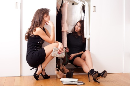 Girls in front of a wardrobe closet photo