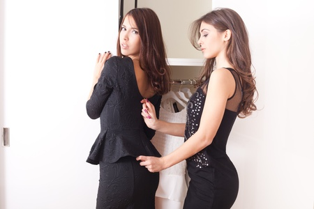 dressup: two young women in front of closet dress-up