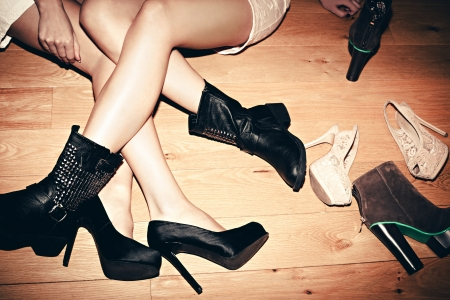 shoes fashion: urban girls with their shoes indoor shot