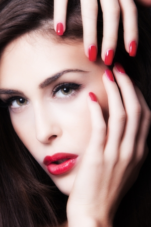 beauty portrait of a young woman with red nails and lips Stock Photo - 17383381