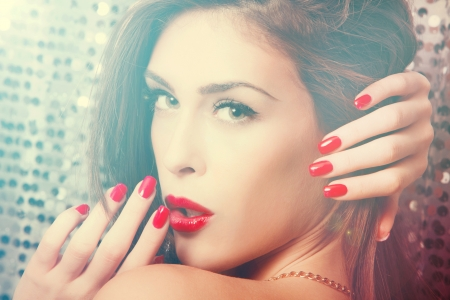 beauty portrait in haze of young woman with red lips and nails