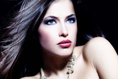 black hair blue eyes: Glamorous beauty blue eyes woman portrait, dark background, studio shot