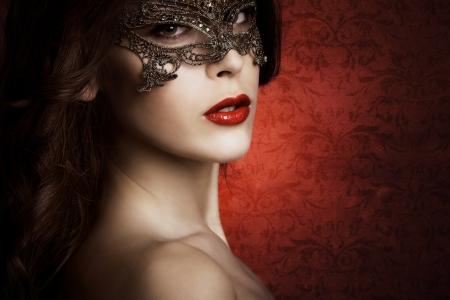 sensual beautiful young woman with lace mask, studio shot photo
