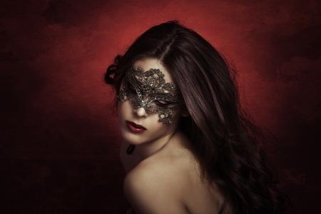 masked woman: sensual beautiful young woman with lace mask, studio shot Stock Photo
