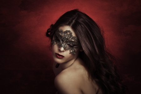 masquerade masks: sensual beautiful young woman with lace mask, studio shot Stock Photo