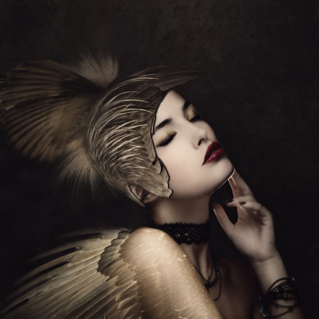 dark angel: battle angel with feather helmet in calm thinking pose small amount of grain added Stock Photo