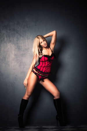 blond attractive woman in red underwear and high heel boots studio shot full body shot photo