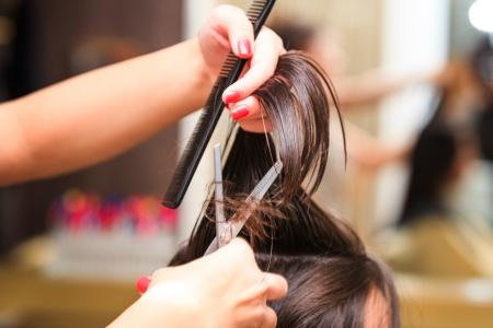 haircut: hairdresser do haircut close up indoor shot