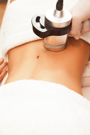 cellulite: cellulite treatment stomach area indoor shot Stock Photo