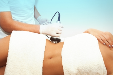 cellulite treatment stomach area indoor shot Stock Photo