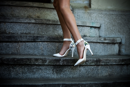 beautiful ankles: woman legs on stairs in elegant white high heel shoes outdoor shot summer day