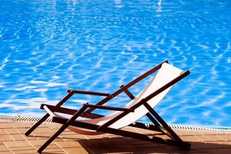 pool deck: deck chair by the pool