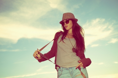 suspenders: young hipster woman portrait with hat and sunglasses outdoor shot retro colors