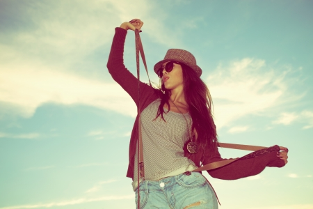 young hipster woman with hat and sunglasses outdoor shot photo