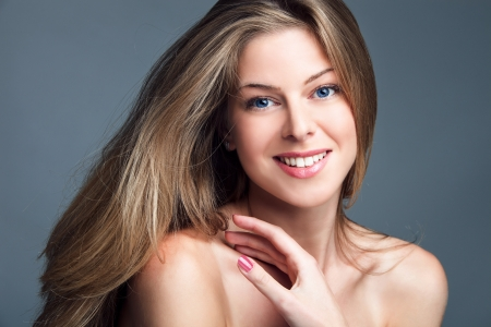 perfect teeth: smiling natural blonde blue eyed  young beauty portrait woman studio shot