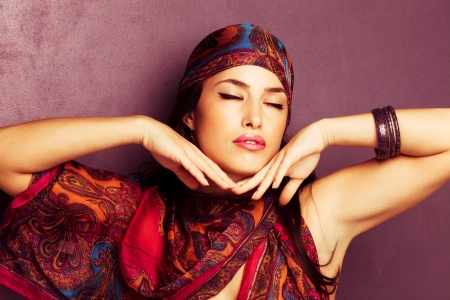 beautiful oriental look young woman portrait with scarf  photo