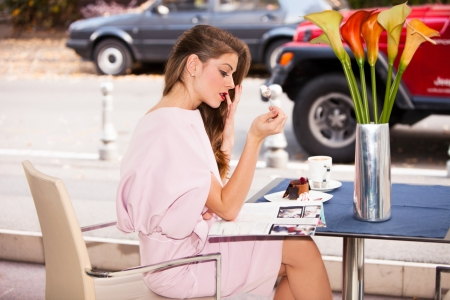 woman eating cake: elegant young woman eating cake  in cafe Stock Photo