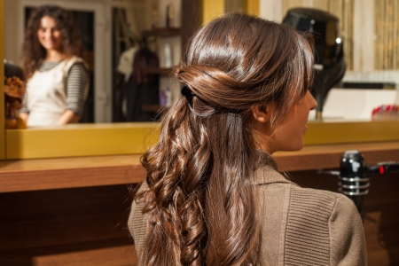 young woman back view of long wavy hair hairdressing salon photo