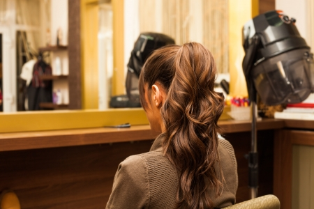 young woman hairdo at hairdressing salon photo