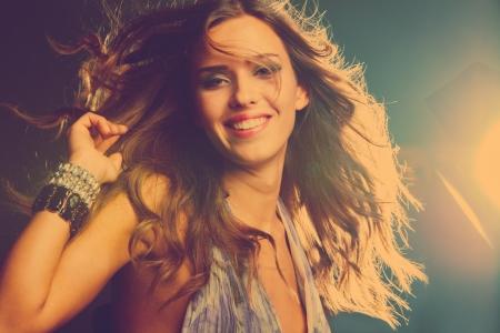 sexy young girls: улыбается молодая девушка танцует в ночном клубе, ретро цветов Фото со стока