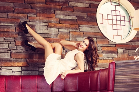 smiling fashion woman in white dress and high heel shoes indoor shot