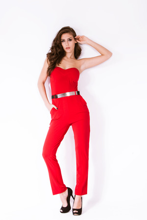 fashion girl in elegant red overalls and high heel shoes full body shot  photo