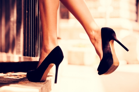woman legs in high heel shoes outdoor shot photo