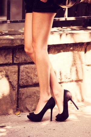 high heel shoes: woman legs in high heel shoes outdoor shot