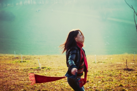 young happy woman run in park misty winter day retro colors  photo