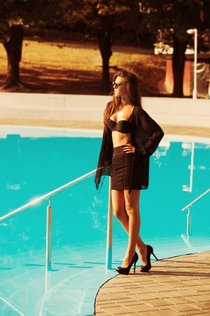 young woman by the pool  enjoy in hot summer day photo