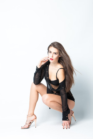 full body shot: sexy woman in black transparent shirt and high heel shoes full body shot, studio