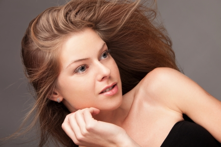 flying hair: young blond woman with flying hair Stock Photo