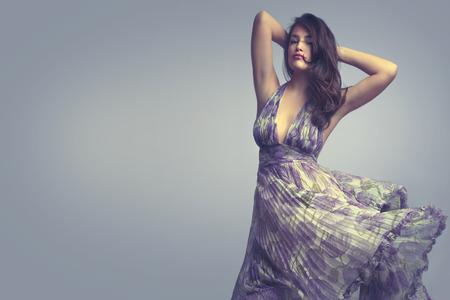 head dress: beautiful woman in elegant  floral dress  Stock Photo