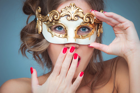 woman with venetian mask gesturing surprise studio shot closeup photo