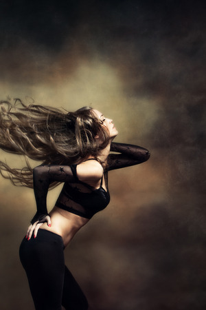 attractive young woman dancing long hair fly Standard-Bild