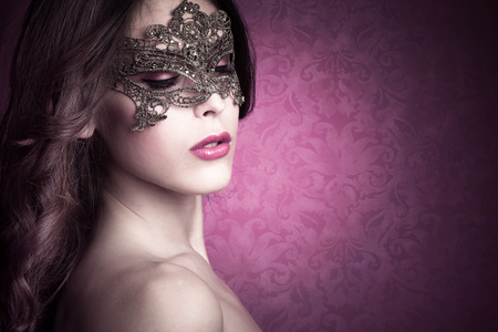 female mask: sensual beautiful young woman with lace mask