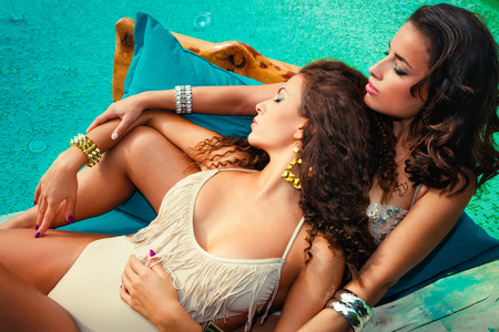beautiful women  by the pool enjoy in sunbath summer  day photo