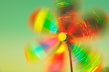 wind mills: rotating colorful pinwheel outdoor shot retro colors