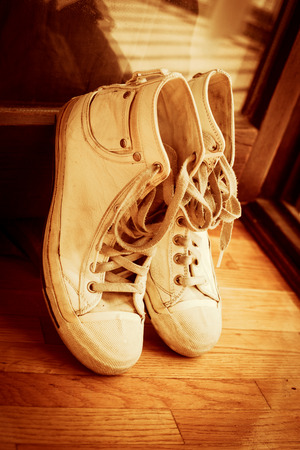 leaned: pair of sneakers leaned on door retro colors Stock Photo