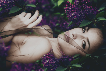 forest nymph in lilac flowers, composite photo