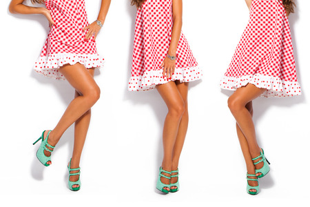 woman legs in summer high heel shoes and short red dress Foto de archivo