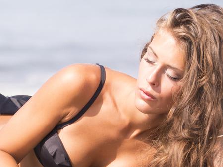 sunbath: sunbath face on the beatch