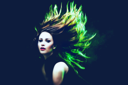 green back: young woman dancing hair in motion green back light