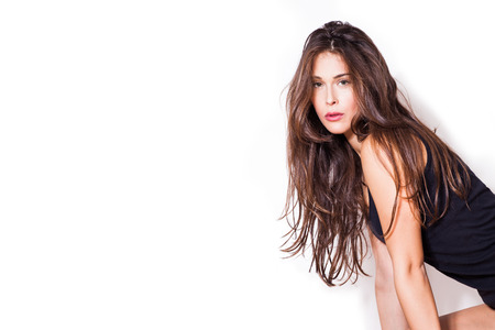 long hair woman: young long hair woman in black  tank top, natural look, against white background, look at camera Stock Photo