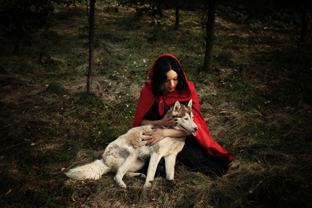 red riding hood and the wolf outdoor in the wood