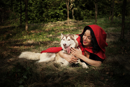 cowl: red riding hood and the wolf outdoor in the wood