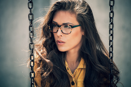 outdoor shot: portrait of young urban woman with eyeglasses, outdoor shot